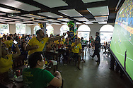 Brazilians cram into a bar in Manaus to watch the Brazil v Croatia match on a big screen. Manaus, Brazil.<br /> Picture by Andrew Tobin/Focus Images Ltd +44 7710 761829<br /> 12/06/2014