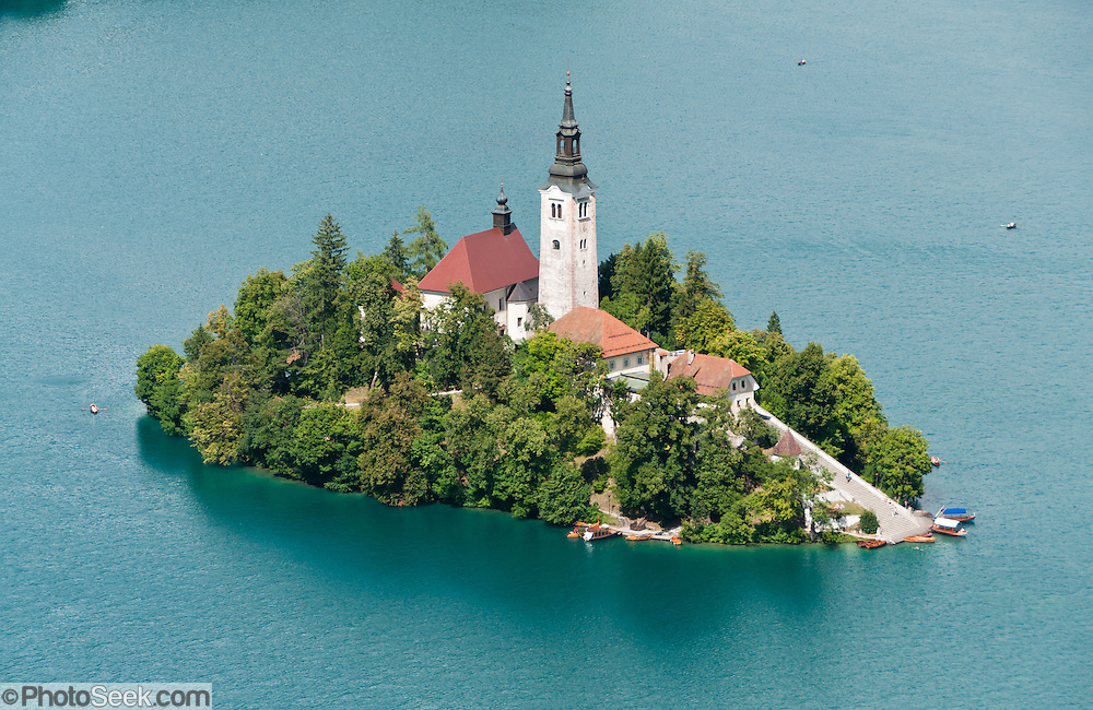 The town of Bled and glacially formed Lake Bled (Slovene: Blejsko jezero) are popular tourist sites in the Julian Alps in northwestern Slovenia. The lake surrounds Bled Island (Blejski otok, the only natural island in Slovenia), upon which stands the Pilgrimage Church of the Assumption of Mary (Slovenian: Cerkev Marijinega vnebovzetja), built in the 15th century and now popular for romantic weddings. Lake Bled hosted the World Rowing Championships in 1966, 1979, 1989, and 2011. The lake is 35 kilometers from Ljubljana International Airport.