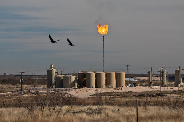 Flare and an oil and gas production site in the Permian Basin in Texas.