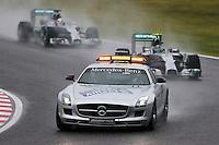Nico Rosberg (GER) Mercedes AMG F1 W05 leads behind the FIA Safety Car.<br /> Japanese Grand Prix, Sunday 5th October 2014. Suzuka, Japan.