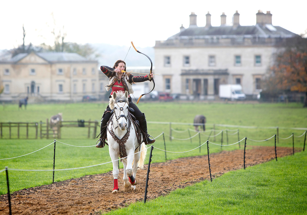 A pair of trick riders have been bringing the ancient art of horseback archery back to the UK. Karl Greenwood (43) and Zana Cousins-Greenwood (38) run the only venue in the UK where horseback archery is taught.<br /> Photograph: Rosie Hallam