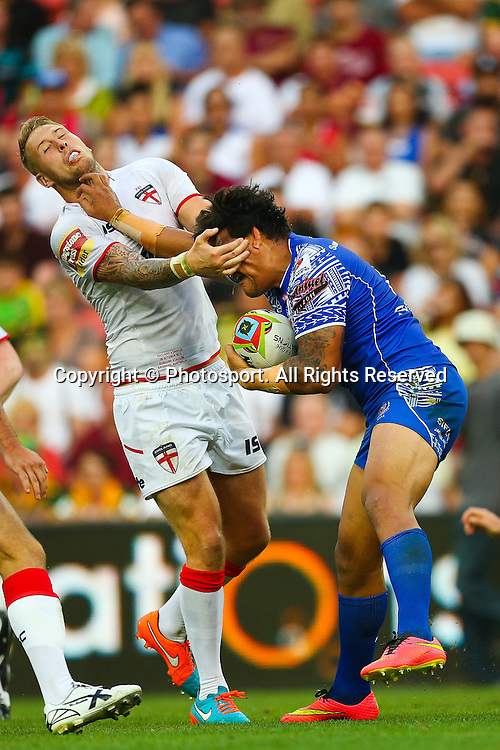 Joey Leilua (R) fends Joe Westerman (L) during the Four Nations test match between England and Samoa at Suncorp Stadium,  Brisbane Australia on October 18, 2014.