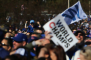 Cubs fans wait for the start of the team's World Series championship rally Friday at Grant Park in Chicago.