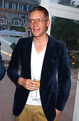 GILES DEACON  at a summer party hosted by champagne house Krug held at Debbenham House, 8 Addison Road, London on 28th June 2005.<br />