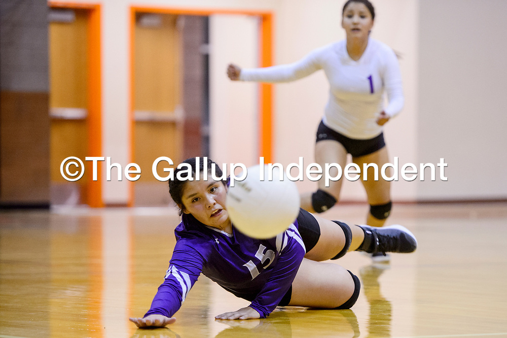 Miyamura Patriot Chenoah Hildreth (15) dives to save a serve from the Gallup Bengals Thursday at Gallup High School.