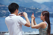 MONACO, MONACO - JUNE 17, 2015: Unidentified asian couple make photos at the viewpoint in Monaco.
