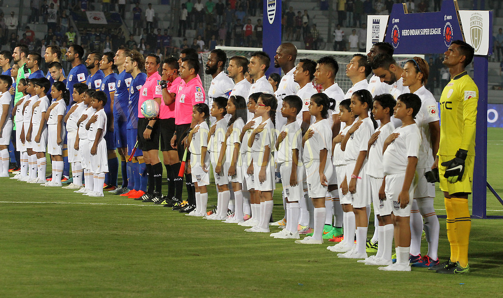 NorthEast United FC and Mumbai City FC players players stand for the national anthem before the start of the match 7 of the Indian Super League (ISL) season 3 between Mumbai City FC and NorthEast United FC held at the Mumbai Football Arena in Mumbai, India on the 7th October 2016.<br /> <br /> Photo by Vipin Pawar / ISL/ SPORTZPICS