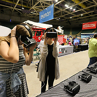 Claire Blassingame, 16, left, and Megan Oates, 17, use virtual realality goggles to watch furnture being made at Thursday's Career Expo at the BancorpSouth Arena in Tupelo.