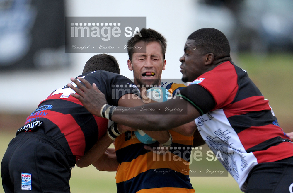PRETORIA, SOUTH AFRICA - Saturday 21 February 2015, <br />  IVAN VENTER from Pretoria Police is tackled by Jean-Pierre Vermeulen from BB Truck Noordelikes and TINY MASEMOLA from BB Truck Noordelikes<br /> during the first round match of the Cell C Community Cup between Pretoria Police and BB Truck &amp; Tractor Noordelikes at the Pretoria Rugby Club.<br /> Photo by ImageSA/SARU
