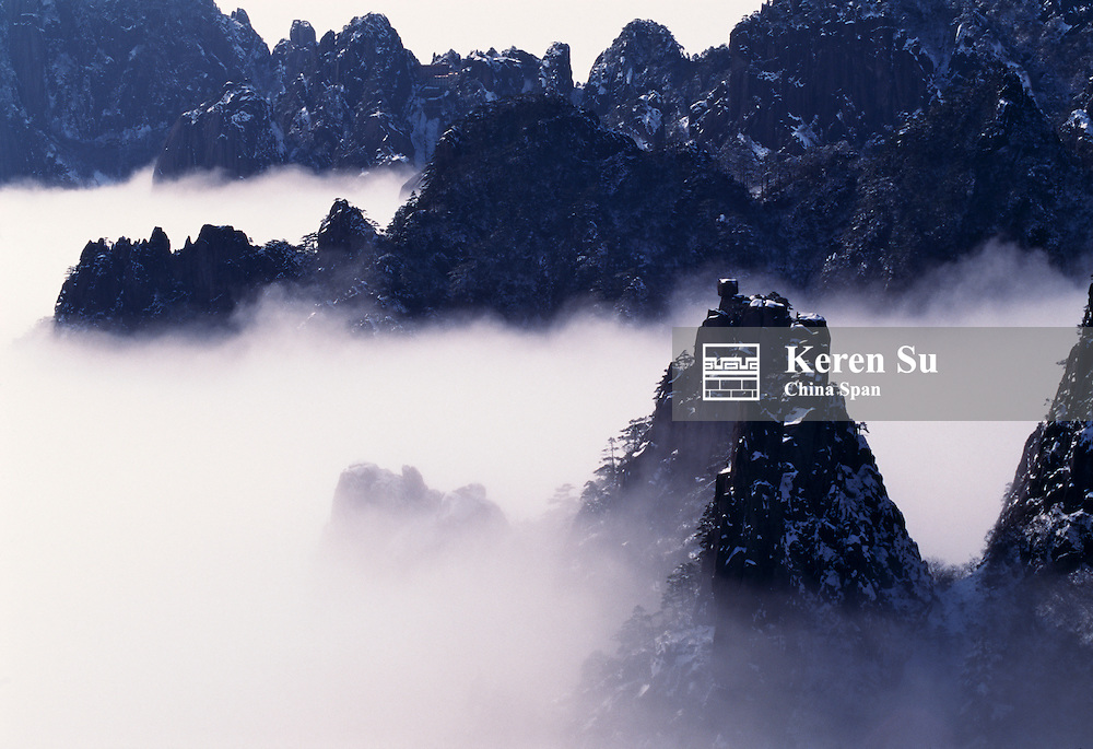 China, Anhui Province, Mount Huangshan, rising above clouds
