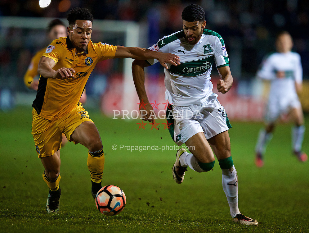 NEWPORT, WALES - Wednesday, December 21, 2016: Newport County Jazzi Barnum-Bobb in action against Plymouth Argyle's Jake Jervis during the FA Cup 2nd Round Replay match at Rodney Parade. (Pic by David Rawcliffe/Propaganda)