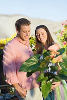 Couple Holding Potted Plant