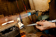 Dans son atelier parisien, le 20 janvier 2011, le sculpteur orfèvre Goudji travaille des pièces de futures créations. Détail des mains de l'artiste au travail. In his Parisian studio, on January 20, 2011, goldsmith Goudji is working new creations of his trade. Detail of Goudji's hands working. Born in Georgia in 1941, Goudji has lived in Paris since 1974, due to the personal intervention of President Georges Pompidou. Here he produces his numerous contemporary works of goldsmithery in such widely differing fields as Church Art, swords, jewellery and sculpture. Picture by Manuel Cohen