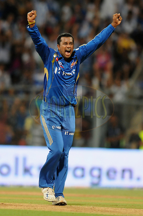 Pragyan Ojha of Mumbai Indians celebrates a wicket during match 28 of the Indian Premier League ( IPL) 2012  between The Mumbai Indians and the Kings X1 Punjab held at the Wankhede Stadium in Mumbai on the 22nd April 2012..Photo by Pal Pillai/IPL/SPORTZPICS.
