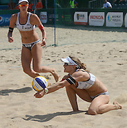 STARE JABLONKI POLAND - July 2: Nadine Zumkehr /1/ and Joana Heidrich /2/ of Switzerland in action during Day 2 of the FIVB Beach Volleyball World Championships on July 2, 2013 in Stare Jablonki Poland.  (Photo by Piotr Hawalej)