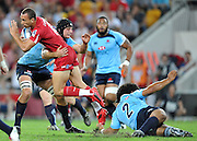 """Quade Cooper runs into the Waratah defence during action from the Super 15 Rugby Union match played between the Queensland Reds and the NSW Waratahs at Suncorp Stadium (Brisbane, Australia) on Saturday 23rd April 2011<br /> <br /> Conditions of Use : NO AGENTS ~ This image is intended for Editorial use only (news or commentary, print or electronic) - Required Images Credit """"Steven Hight - Aura Images"""""""