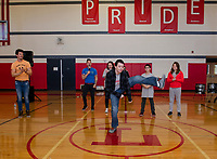 Levi Sanborn shows off his dance moves for Ryan Vezina and Justin Spencer of Recycled Percussion during their surprise visit to Laconia Middle School Monday afternoon.  (Karen Bobotas/for the Laconia Daily Sun)