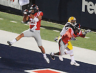 Mississippi defensive back Cody Prewitt (25) intercepts a pass to LSU's Odell Beckham Jr. (3) as Mississippi defensive back Charles Sawyer (3) also defends at Vaught-Hemingway Stadium in Oxford, Miss. on Saturday, October 19, 2013. (AP Photo/Oxford Eagle, Bruce Newman)