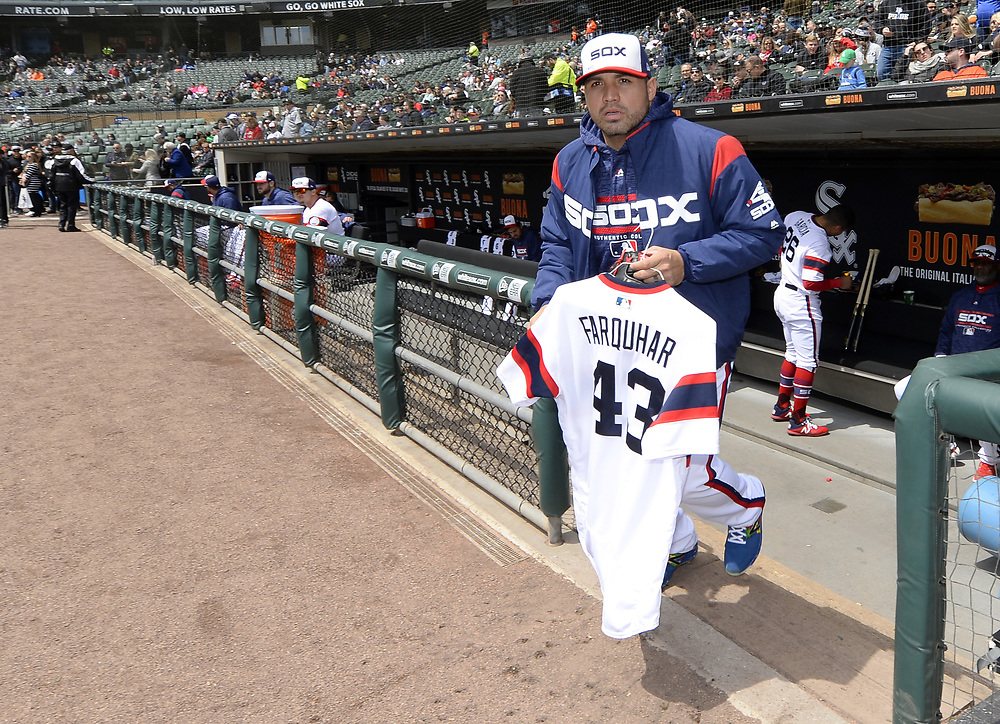 CHICAGO - APRIL 22:  Hector Santiago #53 of the Chicago White Sox carries the jersey of critically ill teammate Danny Farquhar #43 to the bullpen, where it will hang in tribute to their teammate during the game against the Houston Astros on April 22, 2018 at Guaranteed Rate Field in Chicago, Illinois.  (Photo by Ron Vesely)   Subject:   Hector Santiago; Danny Farquhar