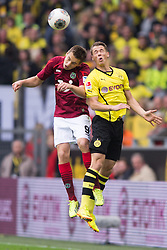 19.10.2013, Signal Iduna Park, Dortmund, GER, 1. FBL, Borussia Dortmund vs Hannover 96, 9. Runde, im Bild Zweikampf zwischen Artur Sobiech (#9 Hannover), Erik Durm (#37 Dortmund)  // during the German Bundesliga 9th round match between Borussia Dortmund and Hannover 96 Signal Iduna Park in Dortmund, Germany on 2013/10/19. EXPA Pictures &copy; 2013, PhotoCredit: EXPA/ Eibner-Pressefoto/ Kurth<br /> <br /> *****ATTENTION - OUT of GER*****