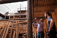 John Huibers instructing one of his workers on Noah's Ark. // A full-sized replica of the biblical Noah's Ark has been built by a Dutch man, complete with model animals, and a four story theatre..Dutch creationist Johan Huibers built the ark as testament to his literal belief in the Bible. After three years of building the Ark should be finished in July. He expects to get around 400.000 visitors a year. Dordrecht, Mei 2011