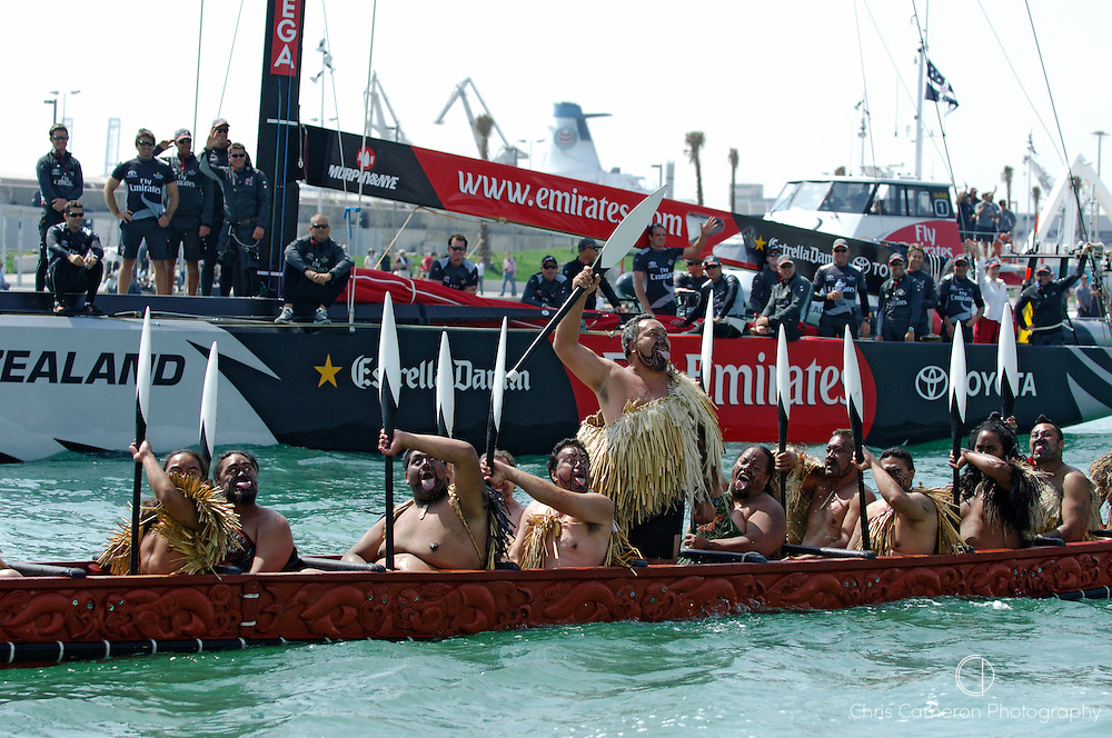 A Maori war canoe (Waka) leads Emirates Team New Zealand NZL92 out of the harbour for the first day of the Louis Vuitton cup. 16/4/2007