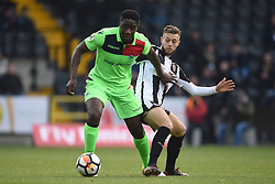 Oxford City's Godfrey Poku (left) and Notts County's Jorge Grant battle for the ball
