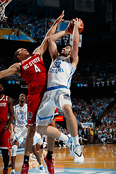 CHAPEL HILL, NC - FEBRUARY 05: Luke Maye #32 of the North Carolina Tar Heels is pressured by Jericole Hellems #4 of the North Carolina State Wolfpack on February 05, 2019 at the Dean Smith Center in Chapel Hill, North Carolina. North Carolina won 113-96. North Carolina wore retro uniforms to honor the 50th anniversary of the 1967-69 team. (Photo by Peyton Williams/UNC/Getty Images) *** Local Caption *** Luke Maye;Jericole Hellems