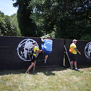 Competitors in action at the wall climb obstacle during the Reebok Spartan Race. Mohegan Sun, Uncasville, Connecticut, USA. 28th June 2014. Photo Tim Clayton