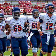#12 Ryan Metz leads the miners on to the field, UTEP at Oklahoma , Norman Oklahoma, September 2, 2017