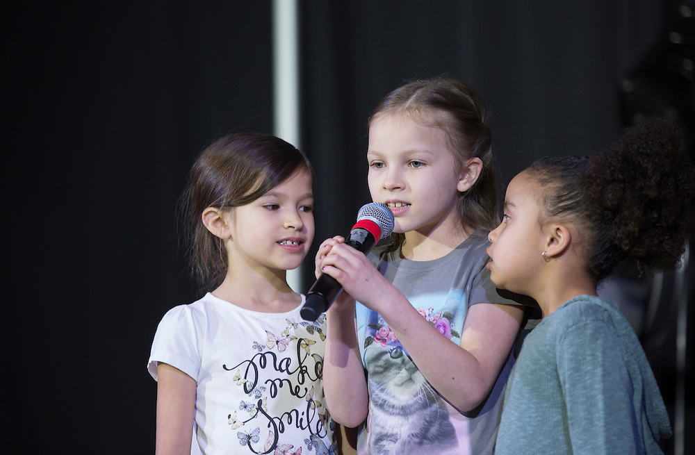 "Assistant Dean of Students Jamie Patton's nieces Avi Figueroa, 7, left, and Sara Figueroa, 9, center, and his daughter Jazmine Patton, 5, right, sing ""We Are the World"" during the Faculty Pageant Show on February 22, 2016."