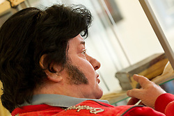 © Licensed to London News Pictures . 07/09/2012 . Manchester , UK . Elvis impersonator , Lewis Gates , studies a personalised bible , given to Elvis Presley by his Uncle Vester and Aunt Clettes for Christmas in 1957 , in the auction room of Omega Auction House . The bible goes up for auction tomorrow (8th September) in Stockport . The bible is expected to fetch £20,000 . It will be auctioned alongside other pieces of Elvis memorabilia , including a pair of the King's underpants . Photo credit : Joel Goodman/LNP
