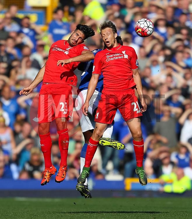 Emre Can and Lucas of Liverpool battle for a header - Mandatory byline: Matt McNulty/JMP - 07966 386802 - 04/10/2015 - FOOTBALL - Goodison Park - Liverpool, England - Everton  v Liverpool - Barclays Premier League