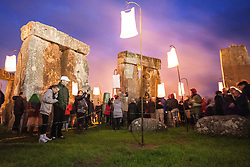 © licensed to London News Pictures. Wiltshire, UK 10/07/2012. People walking around Stonehenge as they enjoy Fire Garden event which is part of the London 2012 Festival and Salisbury International Arts Festival. The heritage site surrounded with fire sculptures and fire posts by French outdoor fire alchemists Compagnie Carabosee. Photo credit: Tolga Akmen/LNP