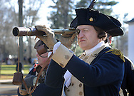 WASHINGTON CROSSING, PA - DECEMBER 7:  George Washington, portrayed by John Godzieba, uses a telescope to have a look at the river during a dress rehearsal for the crossing of the Delaware River at Washington Crossing State Park December 7, 2014 in Washington Crossing, Pennsylvania.  The dress rehearsal is held annually, about two weeks before the Christmas Day reenactment. (Photo by William Thomas Cain/Cain Images)