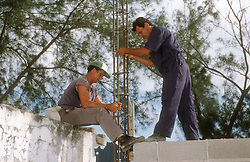 Builders at work on construction site at Gibara; Holguin Cuba,