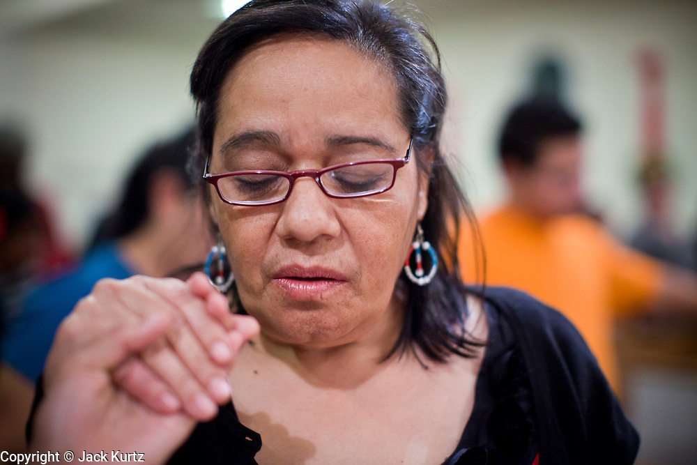 19 DECEMBER 2010 - PHOENIX, AZ:  CARMEN AMAYA prays in support of the DREAM Act in Phoenix. About 100 supporters of the DREAM Act gathered at First Congregational Church of Christ in Phoenix Sunday night, December 19, for a prayer vigil in support of the DREAM Act, which was defeated in the US Senate Saturday, Dec. 18. The DREAM Act, was supported by the Obama administration, and was an important part of the administration's immigration reform platform. The defeat of the DREAM Act, which would have established a path to citizenship for undocumented immigrants who were brought to the US by their parents when they were children, set back the President's immigration reform efforts.    PHOTO BY JACK KURTZ