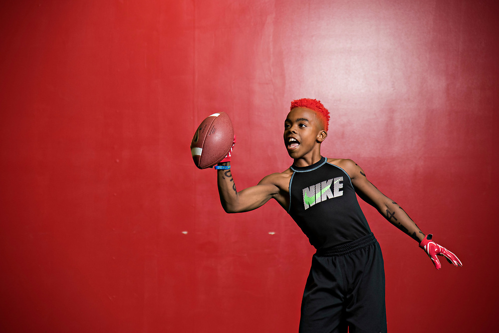 "Maxwell ""Bunchie"" Young, 10, works on his ball-handling skills during rapid fire drills at Laced Facts, an elite training facility in South L.A. that works on speed, strength, and agility for football players."