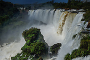 Iguaçù waterfalls, located on the border of the Brazilian state of Paraná and the Argentine province of Misiones, divide the river into the upper and lower Iguazu. View from Argentina's side. The waterfall system consists of 275 falls along 2.7 kilometers of the Iguazu river. The first European to find the falls was the Spanish Conquistador Álvar Núñez Cabeza de Vaca (1541), and the falls were rediscovered by Boselli at the end of the nineteenth century. The falls are shared by the Iguazú National Park (Argentina) and Iguaçu National Park (Brazil), designated UNESCO World Heritage Sites in 1984 and 1987, respectively.