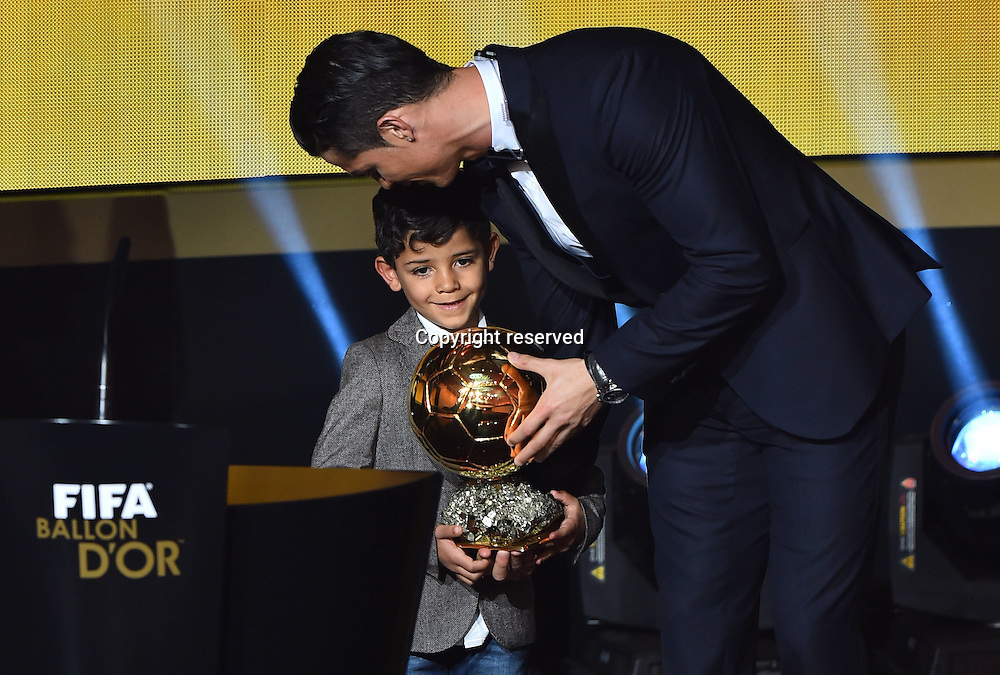 12.01.2015. Zurich, Switzerland. FIFA Ballon d'Or Gala 2014 held at the Kongresshaus in Zurich, Switzerland.  Cristiano Ronaldo shows his trophy FIFA Ballon d Or 2014 to his son