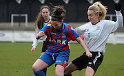 Rhian Humphreys under pressure during the FA Women's Premier League match between Crystal Palace LFC and Bedford Ladies at Bromley Football Club, Bromley, Kent, United Kingdom on 15 March 2015. Photo by Michael Hulf.