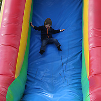 Parker Pace, 3, slides down the giant inflatable slide Saturday at the Tupelo Buffalo Park's Pumpkin Patch