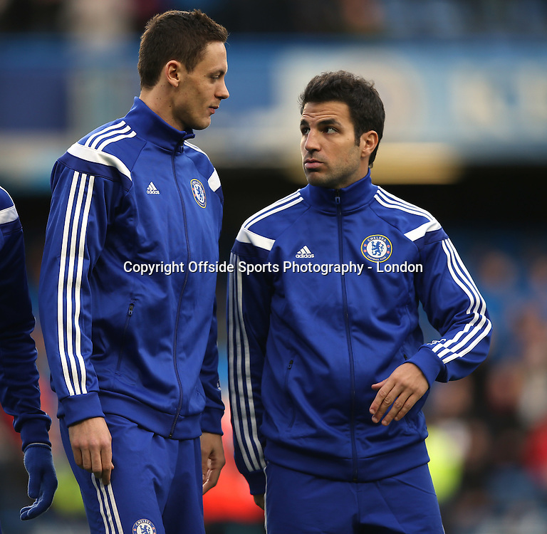 10 January 2015 Premier League Football - Chelsea v Nerwcastle United ;  Nemanja Matic (left) and Cesc Fabregas of Chelsea in discussion.<br /> Photo: Mark Leech