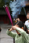 Yonghe Gong (Lama Temple). Worshippers burning incense.