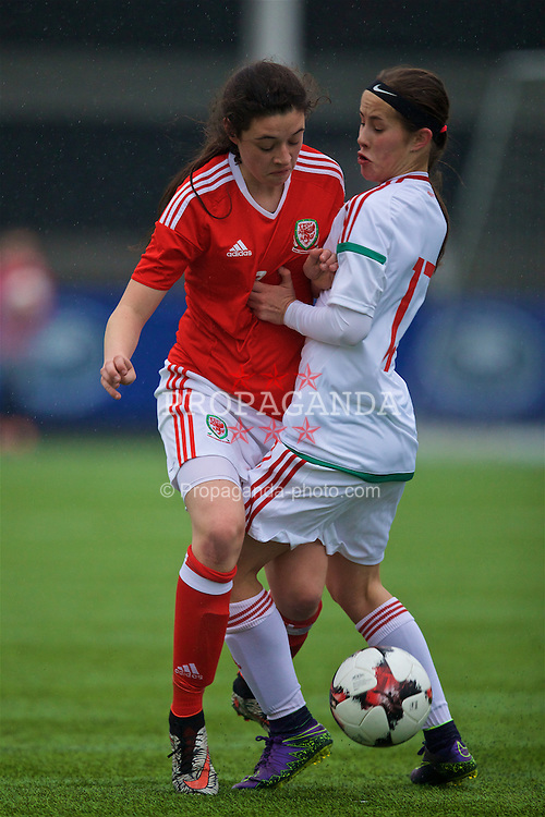 MERTHYR, WALES - Tuesday, February 14, 2017: Wales' Thierry-Jo Gauvain in action against Hungary's Vivien Pintye during a Women's Under-17's International Friendly match at Penydarren Park. (Pic by David Rawcliffe/Propaganda)
