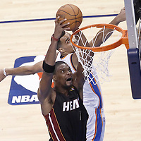 14 June 2012: Miami Heat power forward Chris Bosh (1) dunks the ball past Oklahoma City Thunder shooting guard Thabo Sefolosha (2) during the Miami Heat 100-96 victory over the Oklahoma City Thunder, in Game 2 of the 2012 NBA Finals, at the Chesapeake Energy Arena, Oklahoma City, Oklahoma, USA.