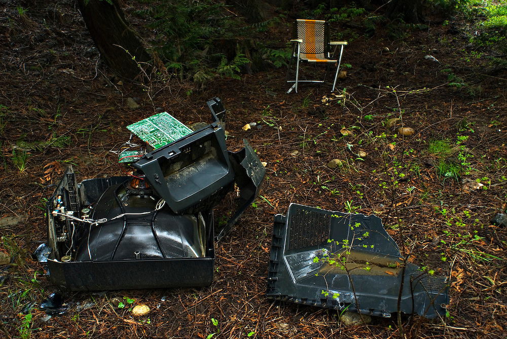 Vernon, BC - 07/05/09 -  A smashed TV set in a forest near Vernon, British Columbia.  Photo by Daniel Hayduk