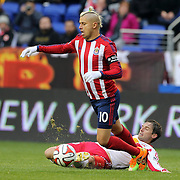 Adolfo Bautista, Chivas USA, is fouled by Bobby Convey, New York Red Bulls, during the New York Red Bulls V Chivas USA, Major League Soccer regular season match at Red Bull Arena, Harrison, New Jersey. USA. 30th March 2014. Photo Tim Clayton