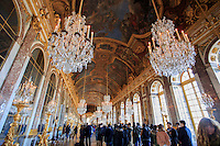 Opulent chandeliers line the roof of the Hall of Mirrors in the Palace of Versailles, Paris, France