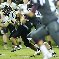 Lauren Wood | Buy at photos.djournal.com<br /> Pontotoc's Gabe Harmon runs the ball during Friday night's game at Kossuth.